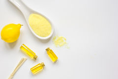 Cosmetic set with seasalt, oils and lemon white background top view mock-up Stock Photos