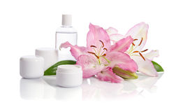 Cosmetic set for skin care with lily Royalty Free Stock Image