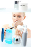 Cosmetic shopping - woman reading label royalty free stock photos
