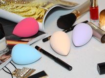 Cosmetic sponge for applying cosmetics on the face. Pink color royalty free stock photo