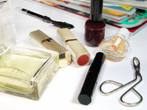 Cosmetic still life. A table with different cosmetic items and some fashion magazines Royalty Free Stock Images