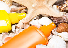 Cosmetic sunscreen products with shells and starfish Stock Photography