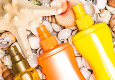 Cosmetic sunscreen products with variety of shells and starfish Stock Photography