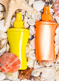 Cosmetic sunscreen products with variety of shells and starfish Royalty Free Stock Photo