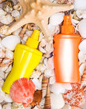 Cosmetic sunscreen products with variety of shells and starfish Stock Photo