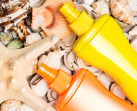 Cosmetic Sunscreen Products With Variety Of Shells And Starfish Stock Images