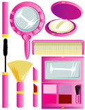 Cosmetic Supplies. An assortment of cosmetics isolated against a white background - a mirror, powder, mascara, makeup brush, lipstick, comb and eyeshadow compact Royalty Free Stock Image