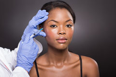 Cosmetic surgeon injecting Royalty Free Stock Images
