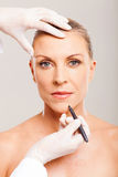 Cosmetic surgeon marking Stock Photography