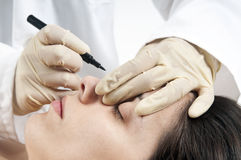 Cosmetic surgery. Woman preparing for cosmetic surgery Royalty Free Stock Images