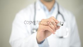 Cosmetic Surgery , Doctor writing on transparent screen. High quality Royalty Free Stock Image