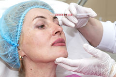 Cosmetic surgery. Cosmetic treatment with injection in a clinic Stock Image