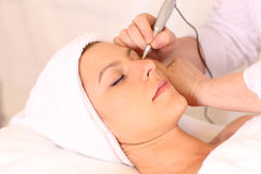 Cosmetic Tattoo. Being applied in beauty clinic stock image