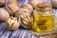Cosmetic and therapeutic walnut oil. Food and cosmetic concept photo.  royalty free stock photos