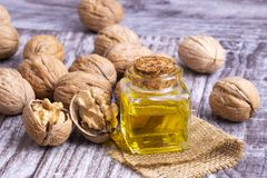 Cosmetic and therapeutic walnut oil. Food and cosmetic concept photo.  stock photos