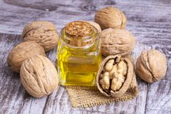 Cosmetic and therapeutic walnut oil. Food and cosmetic concept photo.  royalty free stock photo