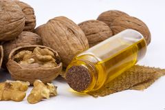 Cosmetic and therapeutic walnut oil. Food and cosmetic concept photo.  stock images