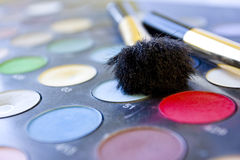 Cosmetic tools. Black brush and color palette Stock Photos
