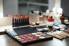 Cosmetic and tools of professional makeup artist. On table indoors Royalty Free Stock Image