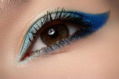 Cosmetic & visage. Macro of blue eye make-up Stock Photos