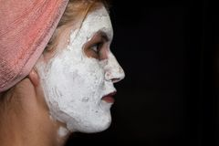 Cosmetic white face mask of toothpaste. Woman in white cosmetic mask. Cosmetic white face mask of toothpaste. Woman in a white cosmetic mask stock images