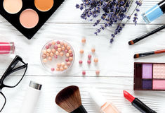 Cosmetic on white table with lavender top view Royalty Free Stock Photography