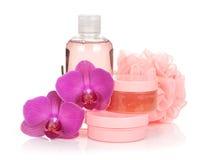Cosmetici e fiori dell'orchidea Fotografia Stock