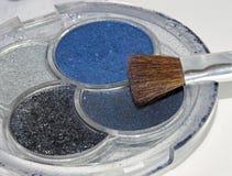 Cosmetici variopinti di trucco affinchè donne cambino il colore della e Immagine Stock