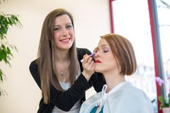 Cosmetician applying eye makeup Stock Photos