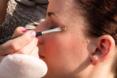 Cosmetician doing make up Stock Photography