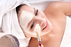 Cosmetician make mask. Facial massage. Stock Photos