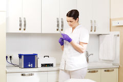 Cosmetician preapring tools for sterilization Stock Images