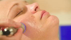 Cosmetician providing lifting procedure with
