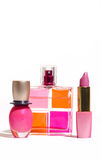 Cosmetics. Pink perfume bottle,lipstick and nail isolated Stock Photography