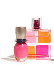 Cosmetics. Pink perfume and nail isolated on the white Stock Photo