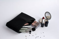 Cosmetics. In a black bag including red lipstick and makeup mirror Royalty Free Stock Photos