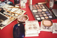Cosmetics. Various make up things on a red table Royalty Free Stock Photography