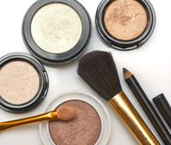 Cosmetics. Makeup brush and cosmetics, make-up suggestions Stock Image