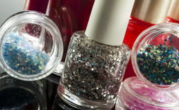 Cosmetics. Make up and nailpolish on reflex background royalty free stock photography