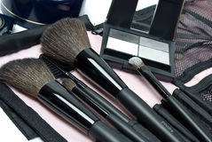 Cosmetics. The eye shadows and makeup brushes Stock Photography