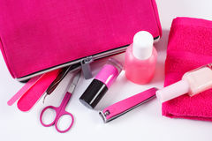 Cosmetics and accessories for manicure or pedicure with pink bag cosmetic, concept of nail care Stock Photos