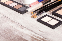 Cosmetics and applicators on wood Royalty Free Stock Images