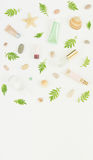 Cosmetics background. Cosmetics SPA makeup tubes, bottles, sea pebbles and shells on white background. Flat lay, top Stock Photo