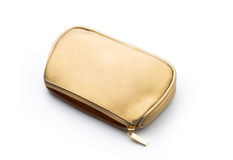 Cosmetics bag. Bag for cosmetics gold color, white background Stock Image