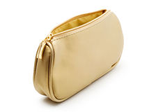 Cosmetics bag. Bag for cosmetics gold color, white background Royalty Free Stock Photography