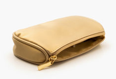 Cosmetics bag. Bag for cosmetics gold color, white background Stock Photography
