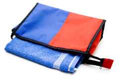 Cosmetics bag with blue towel Royalty Free Stock Image
