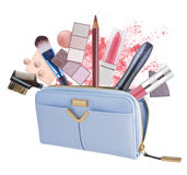 Cosmetics bag with flying out makeup products isolated on white Royalty Free Stock Photography