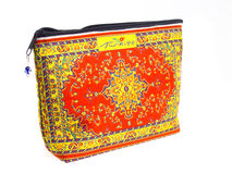 Cosmetics bag with multycolored pattern. Stock Photo