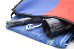 Cosmetics bag with toothbrush and oral mug Stock Photo